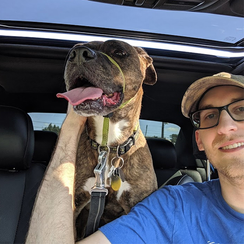 Man in car with dog