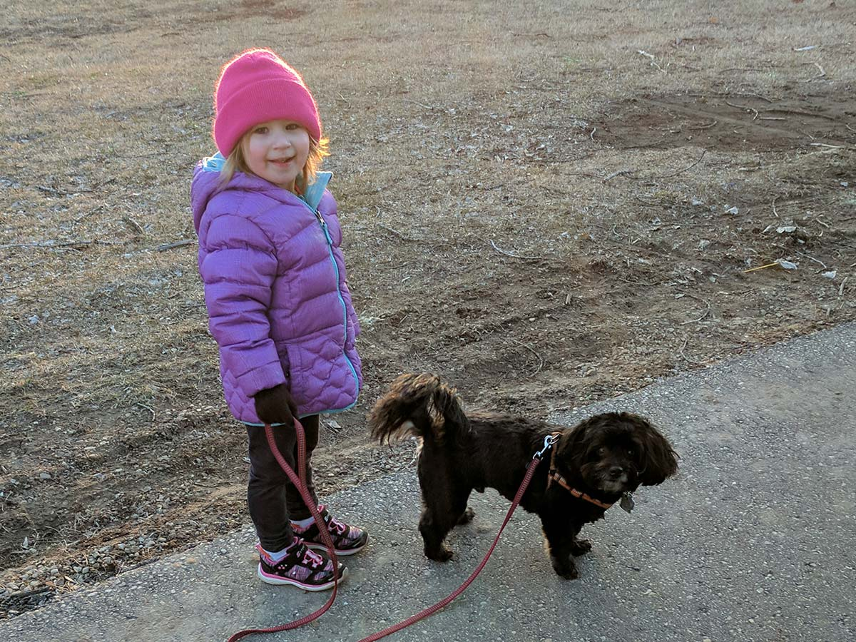 little girl with little dog